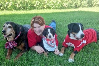 Andrea Christenson with her service dogs, which she trained to help her cope with psoriatic arthritis.