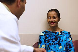 Dr. Vikas Majithia with a patient with rheumatoid arthritis.